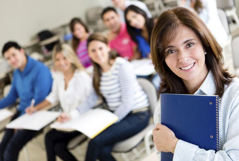 Professional woman in classroom with clipboard