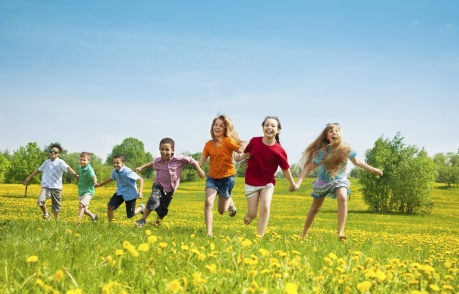Children running and laughing in a field