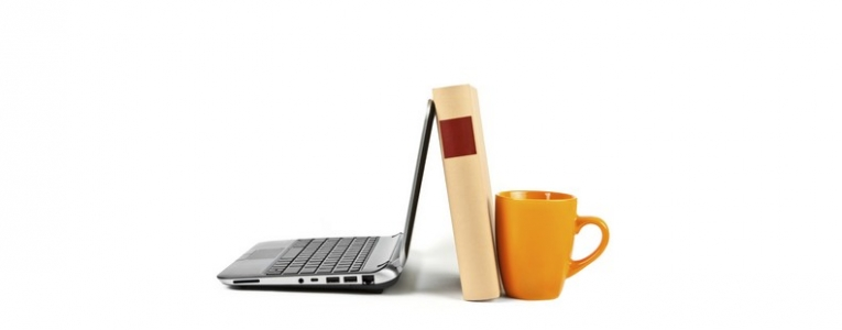 laptop and book and mug for adult assessment